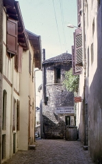 Fortifications -  Street of the Augustines, view to the tower of the medieval walls.