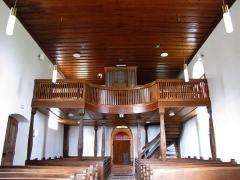 Eglise simultanée Saint-Jean-Baptiste de Hohwiller -  Alsace, Bas-Rhin, Soultz-sous-Forêts, Église simultanée Saint Jean-Baptiste de Hohwiller (PA00084752, IA00119010): Vue intérieure de la nef vers la tribune d'orgue.