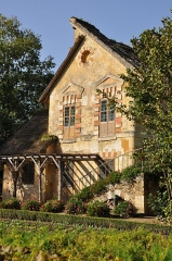 Domaine national de Versailles - English: South facade of watermill in the hameau de la Reine, the Queen's Hamelet in Palace of Versailles in the department of Yvelines, France.