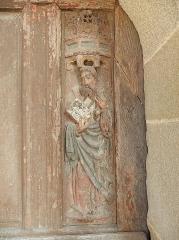 Eglise de la Trinité - Français:   Détail de la porte de la sacristie de l\'église de La Trinité-Langonnet (56).