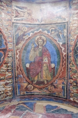 Basilique Saint-Julien - English: Christ in Majesty with the evangelists, angels, and saints; vault fresco (13th c.) of the chapel St Michel in the basilica of St Julian in Brioude.