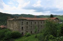 Ancienne abbaye de Pébrac - English: Abbey of Pébrac. South and East facades of convent buildings.