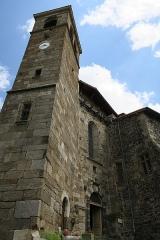 Ancienne abbaye de Pébrac - English: Abbey of Pébrac. West facade of abbey church and bell tower.