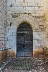 Eglise du Saint-Sépulcre - English: Side door of the church of the Holy Sepulchre of Villeneuve, Aveyron, France