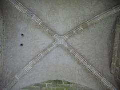 Eglise Saint-Barthélémy - Français:   Croisée d\'arcs du porche de l\'église Saint-Barthélémy de Liginiac (Corrèze, France)
