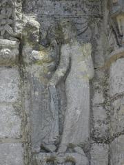 Ancienne abbaye Saint-Jouin - Façade occidentale de l'abbatiale Saint-Jouin de Saint-Jouin-de-Marnes (79). 1er étage. Section centrale. Détail. Annonciation.