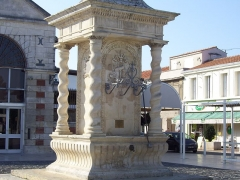 Fontaine - This building is indexed in the Base Mérimée, a database of architectural heritage maintained by the French Ministry of Culture, under the reference PA00104646 .