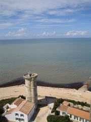Vieux Phare des Baleines et phare des Baleineaux -  The old tower and in the ocean, barely perceptable, another lighthouse.