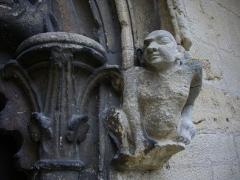 Abbaye - Église collégiale Saint-Étienne de Gorze (Moselle, France).  Tympan du portail nord-est: démon