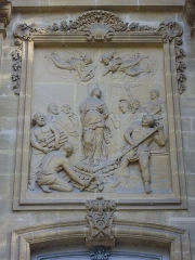 Eglise Saint-Vincent - Français:   Église Saint-Vincent de Metz (Moselle, France); bas-relief, à droite du portail d\'entrée, représentant le martyre de sainte Lucie