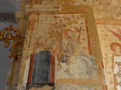 Eglise paroissiale Notre-Dame - Fresques ornant le mur est de la chapelle Sainte-Anne de l'église Notre-Dame de Cossé-en-Champagne (53). Ange, Vierge à l'Enfant, Saint-Christophe et l'Enfant Jésus.