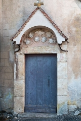 Eglise -  Door of the sacristy of the parrish church's of Mont-Saint-Jean, Côte-d'Or representing se Holy Spirit.