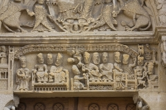 Eglise Saint-Hilaire -  The lintel of the west porch show Hilary at the Council of Seleucia in 359, where he came to fight the Arianism . Hilary, bishop of Poitiers, is shown seated on the ground between the Council Fathers sit down on benches. On the right is represented the death of pseudo Pope Leo, president of the council and partisans of the heresy of Arius.