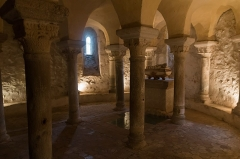 Prieuré - English:  Main apse of the crypt based on eighteen marble columns, for a part step into, coming probably from the Roman baths of Moingt. The vault rests on capitals decorated with interlacing of plants typical of the eleventh century.