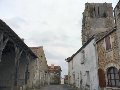 Halle - English: Street in the village center, with the ancient covered market and the gothique church. Saint-Jean-d'Angle, Charente-Maritime, Poitou-Charentes, France, Europe.