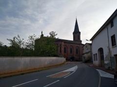 Ancienne église prieurale - Français:   La route départementale 9 (rue Georges Fouilland), en arrivant à Régny depuis l\'est et l\'église Saint-Julien (MH, inscrit), à Régny (Loire, France).