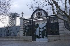 Ancienne manufacture nationale d'armes de Saint-Etienne -  The portal de la Manufacture d'Armes, scrolls and foliage