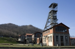 """Site minier dit """" Puits Couriot """" - English:  Winding towers of the pit Couriot, seen fron the mine couryard."""