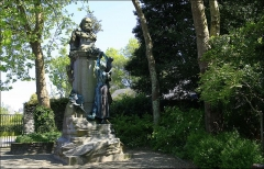 Statue de Jean-François Millet dans le jardin public, à Octeville - This building is indexed in the Base Mérimée, a database of architectural heritage maintained by the French Ministry of Culture, under the reference PA50000050 .