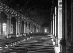 Eglise -  Interior of the Galerie des Glaces showing the arrangement of tables for the signing the Treaty of Versailles in Versailles, France. This photo was taken the day before the signing of the treaty.