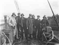 """Eglise - English: These are the crew members of a Norwegian vessel, who survived what is known as the Fethard Lifeboat Disaster.    These men were on board their vessel, The Mexico (with its cargo of mahogany and cedar from Mexico), when it ran aground on the Keragh Islands, Co. Wexford on Friday, 20 February 1914. The Fethard Lifeboat, Helen Blake, came to their rescue through a storm was destroyed with the loss of 9 of the 14 lifeboatmen.    For those of you wanting to know more about this disaster, Niall McAuley provided a link to this PDF recounting the whole story, and a tentative identification of the older sailor in the middle as the captain of The Mexico, Ole Edvin Eriksen, of Frederikshald, Norway...    Fairly happy now that this photo was taken at Waterford, thanks to John Spooner's contribution from a report in The Times of 24 February that said:  """"The tug with the nine men on board and the body of the man who had died on the island arrived at Waterford at 4 o'clock. A great crowd assembled on the quays to welcome the rescuers.""""    Date: Tuesday, 24 February 1914     NLI Ref.: P_WP_2536"""