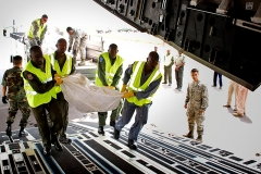 Eglise -  Members of the Rwanda Defense Forces push a Rwandan carry tents into the cargo hold of a U.S. Air Force C-17 Globemaster III aircraft in Kigali, Rwanda, Jan. 14, 2009. The Rwandan soldiers are preparing to deploy to Sudan in support of an African Union/United Nations peacekeeping mission. About 150 tons of equipment, including the vehicles, purification systems, water trailers, tents and spare parts, will be airlifted by a U.S. Air Force C-17 Globemaster III cargo aircraft to Rwandan peacekeepers that are supporting the mission in Darfur. (DoD photo by Staff Sgt. Samuel Bendet, U.S. Air Force/Released) <a href=