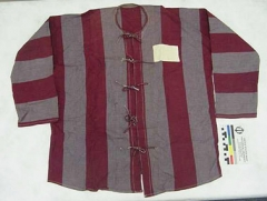 "Allée couverte -  Accession: 75-71-A Shirt, Prisoner of War, North Vietnamese 30""H X 25.5 W Shirt worn by Lt Carl T. Wieland while being held captive in Vietnam. LT Wieland was shot down on December 20th 1972 while on a mission from the carrier USS AMERICA CV-66. LT Wieland was released on March 29th 1973. He was awarded the Bronze Star with Combat ""V"" for his service. Collection of Curator Branch, Naval History and Heritage Command"