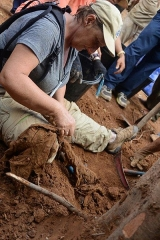 Allée couverte - English: Anthropologist examining articles found at Vietnam War excavation site.