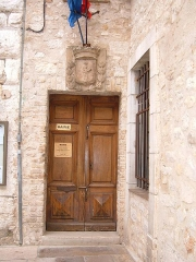 Tour du 12s -  The door of the town hall in Saint-Paul de Vence, Alpes-Maritimes department, France.