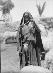 Eglise Saint-François-de-Sales et abords - English: Title: A Bedouin shepherdess of Sharon. Spinning yarn as she goes Abstract/medium: G. Eric and Edith Matson Photograph Collection  Physical description: 1 negative: