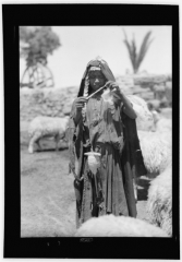 Eglise Saint-François-de-Sales et abords - English: Title: A Bedouin shepherdess of Sharon. Spinning yarn as she goes Abstract/medium: G. Eric and Edith Matson Photograph Collection  Physical description: 1 negative :