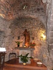 Chapelle Notre-Dame de la Pépiole - Français:   Cette statue de Vierge à l\'Enfant en bois doré de sorbier a été placée dans l\'abside nord  de la chapelle N-D de Pépiole