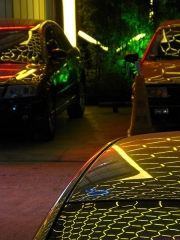 Hôtel de Montfaucon -  A restaurant with amazing lights in Shanghai. The lights change between blue and yellow. Reflected in a car.