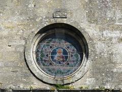 Eglise de la Décollation de Saint-Jean-Baptiste - Français:   La rosace occidentale de l\'église, Fanlac, Dordogne, France.