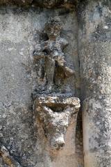 Eglise Saint-Pierre -  Eglise Saint-Pierre de Petit-Palais-et-Cornemps (33)    13th century date QS:P,+1250-00-00T00:00:00Z/7, 18th century date QS:P,+1750-00-00T00:00:00Z/7, 19th century date QS:P,+1850-00-00T00:00:00Z/7  Detail of the Facade, Man Taking a Thorn from his Foot
