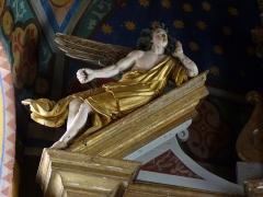 Eglise Saint-Martin -  L'ange de gauche du retable de l'église Saint-Martin de Caupenne