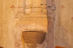 Eglise Saint-Girons - Français:   Bénitier des cagots et tête sculptée présumée d\'un cagot