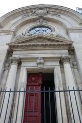 Temple du Marais ou temple Sainte-Marie (ancienne chapelle du couvent des filles de la Visitation dite église de la Visitation) -  Temple du Marais in Paris, main door and pediment with the statues of Charity (right) and Religion (left) by Ernest-Eugène Hiolle