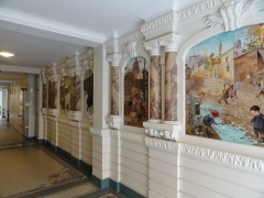 Immeuble -  Panorama of the entrance corridor of the 1900 building 43 bis rue Damrémont - Paris. The entrance is covered with ceramics drawn by the French painter Poulbot.