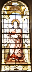 Eglise de Lorrez-le-Bocage - Français:   Sainte Thérèse d\'Avila (1515 - 1582): Née en 1515, dans une noble famille d\'Avila en Castille. Elle entre à 20 ans au Carmel et se rend compte que les pratiques religieuses de cet Ordre se sont dégradées. Elle veut le réformer pour le faire revenir à la règle primitive, malgré bien des résistances. Elle fonde de nombreux couvents en Espagne. Elle vit des expériences mystiques très fortes et rencontre Saint Jean de la Croix, lui-même mystique. Elle nous a laissé des écrits de haute spiritualité, en particulier \