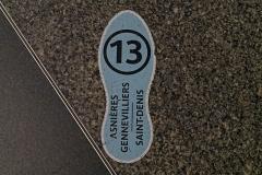 Métropolitain, station Saint-Lazare -  Sign of Paris Metro on the floor.