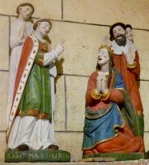 Chapelle Saint-Sébastien de Guernilis - Français:   Briec: chapelle Saint-Sébastien de Garnilis, groupe sculpté de saint Mathurin et Théodora, fille de l\'empereur Maximilien Hercule, qui était folle et que saint Mathurin tenta de soigner (1er quart XVIème siècle).