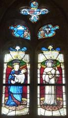 Eglise Saint-Hilaire - Français:   Clohars-Fouesnant: église paroissiale Saint-Hilaire, vitrail du XVIème siècle, Vierge à l\'Enfant et saint Maurice