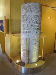 Château d'Aulteribe - English: Roman milestone preserved in the espace du temple de Mercure (Puy-de-Dôme, France). The text is Tiberius Claudius Cesar Auguste Germanicus, son of Drusus, supreme pontif, holder of his fifth Tribunician Power, eleven times acclaimed emperor, father of the country, three times consul, consul designate for the fourth time. Augustonemetum twenty-one thousand steps.