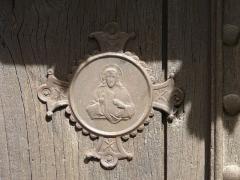 Maison Clare - Français:   Bas-relief sur la porte de la maison Clare, rue Patata, Beaulieu-sur-Dordogne, Corrèze, France.