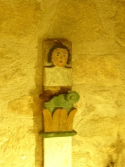 Eglise Saint-Cyr-Sainte-Julitte - Français:   Montant en bois polychrome représentant un ange, église de Saint-Cirgues-la-Loutre, Corrèze, France.