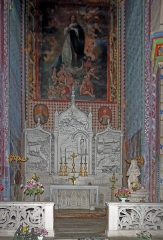 Eglise Saint-Vincent -  Chapel of Our Lady of Lourdes: The altar, the altarpiece, the panelling and the chapel's fence are the work of a local sculptor, Denat (1865)..