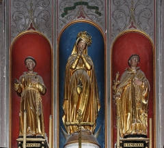 Eglise Saint-Vincent -  The altarpiece in the chapel of the Immaculate Conception shows the Virgin is surrounded by St. Dominic and St. Francis of Assisis.