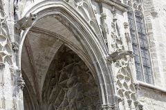 Eglise Saint-Vincent -  Finely carved in lanceolate gothic style, the south porch is flanked by two gargoyles.