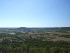 Oppidum -  The village of Nages is dominated by the two Gaulish oppidums of Roque de Viou, and of Nages on the Roque de Viou hill to the north. Panorama.  The Voie Verte skirts Calvisson and is clarly seen turning round the settlement tanks at the sewage works.